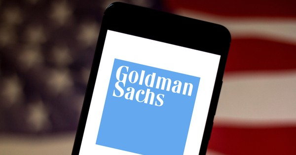 Goldman Sachs text displayed on a mobile phone screen.