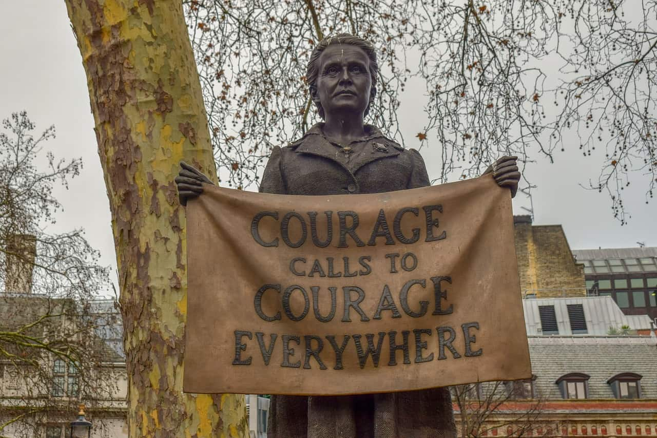 "Statue of Millicent Fawcett, where she holds a banner reading ""Courage Calls to Courage Everywhere"""